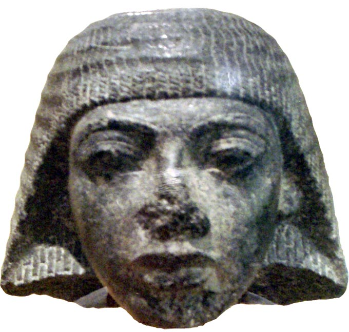 Part of a statue depicting Ramses I as a scribe during the reign of Horemheb.