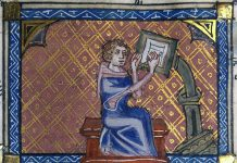 The author of a manuscript at his writing desk. 14th Century