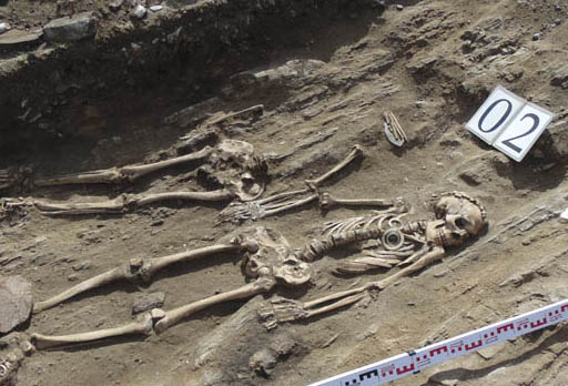 Male and female skeletons from Bronze age holding hands.
